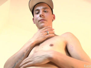 Skinny twink hotly undresses and wanks off to  the camera
