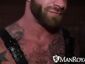 Tattooed and bearded hunk in leather belts fucks hard young twink