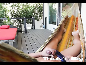 Twink is lying in hammock outdoors and pleasantly wanking off