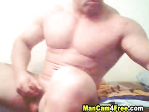 Big and strong twink is pleasing himself with exciting dick masturbation